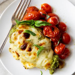 pesto chicken with tomatoes on a plate