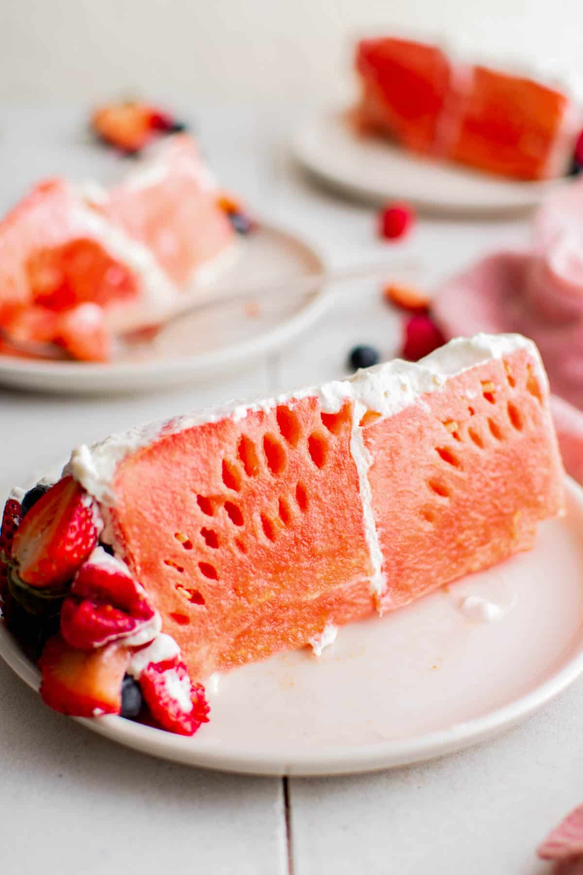 one slice of watermelon cake on a plate