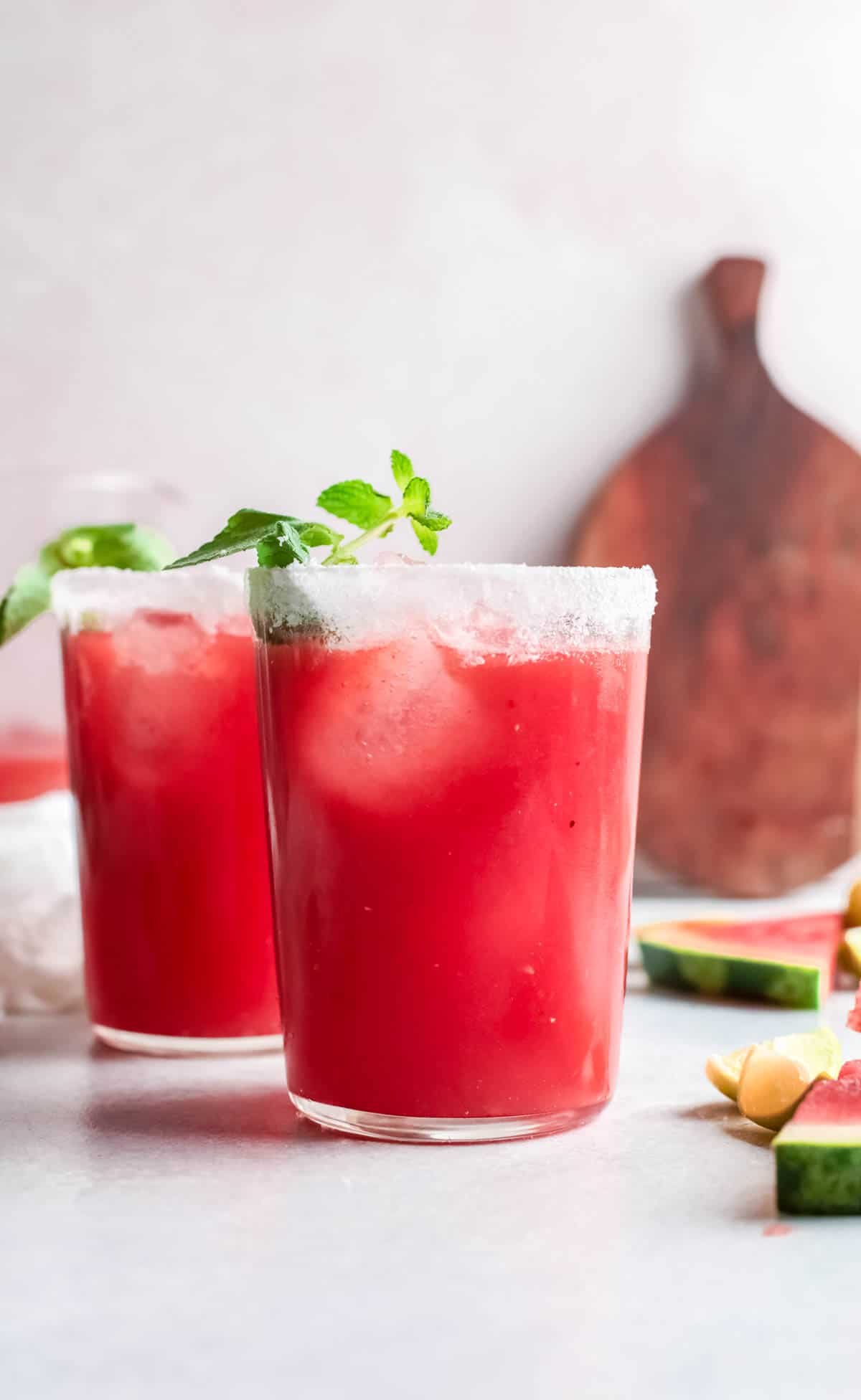 two watermelon paloma drinks on a tabletop
