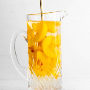 mixing together ingredients in a pitcher