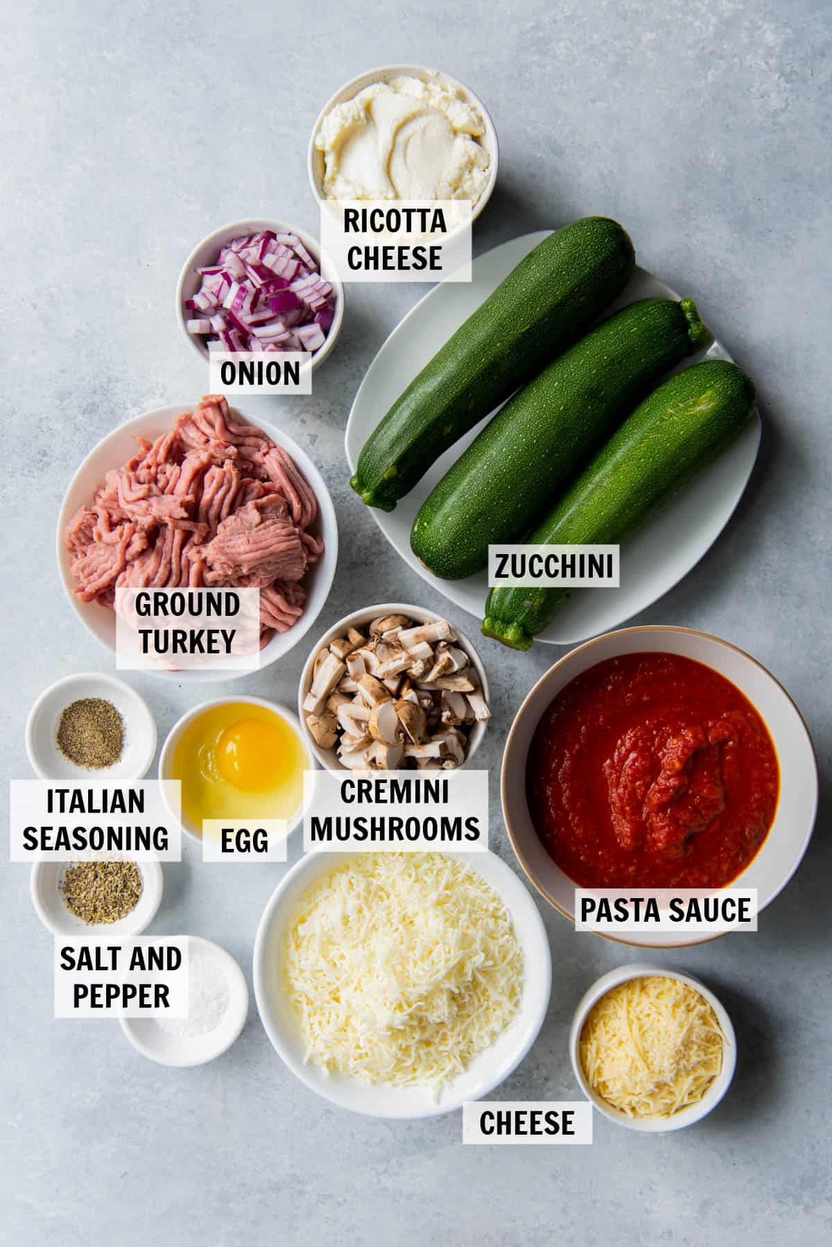all of the ingredients for zucchini lasagna on a countertop