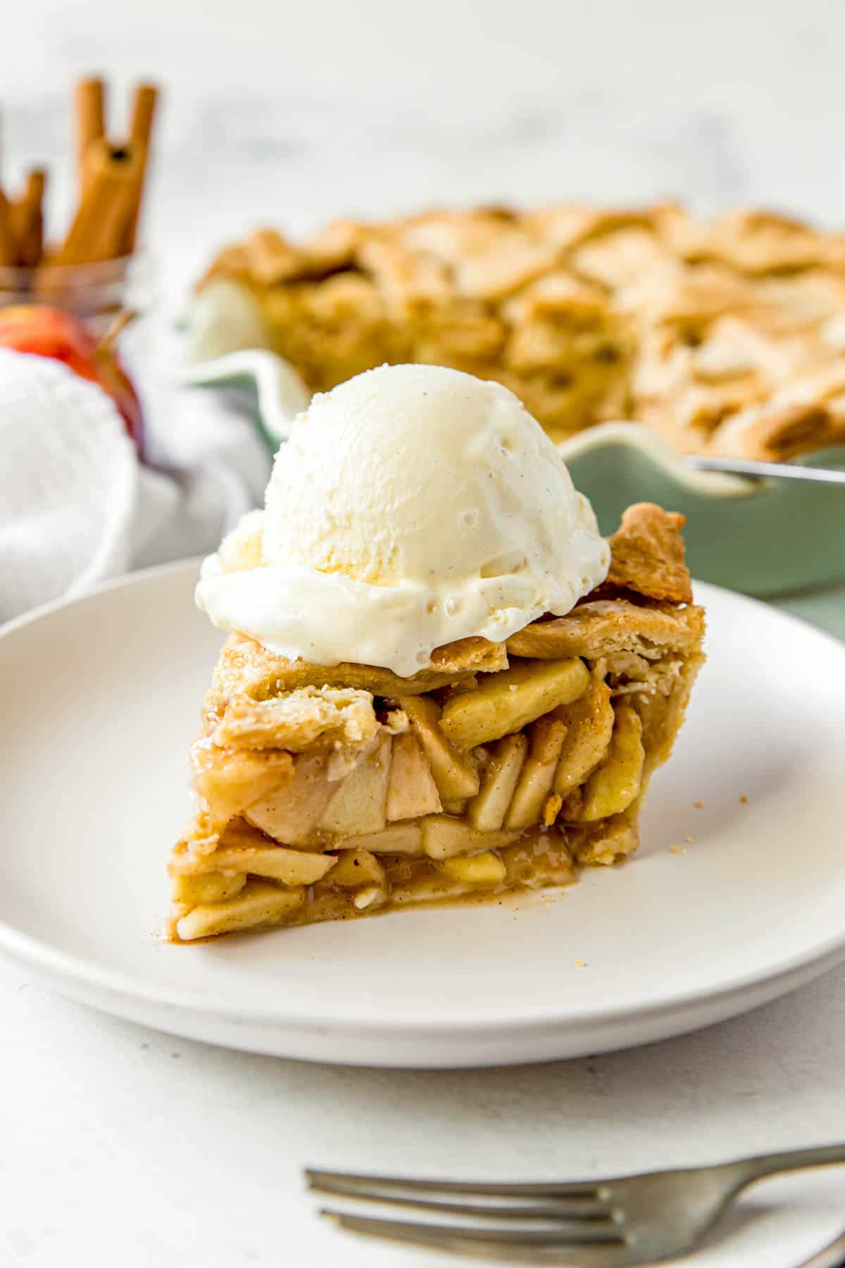 slice of apple pie with a scoop of ice cream on top