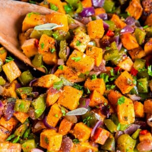 a skillet filled with cooked sweet potato hash