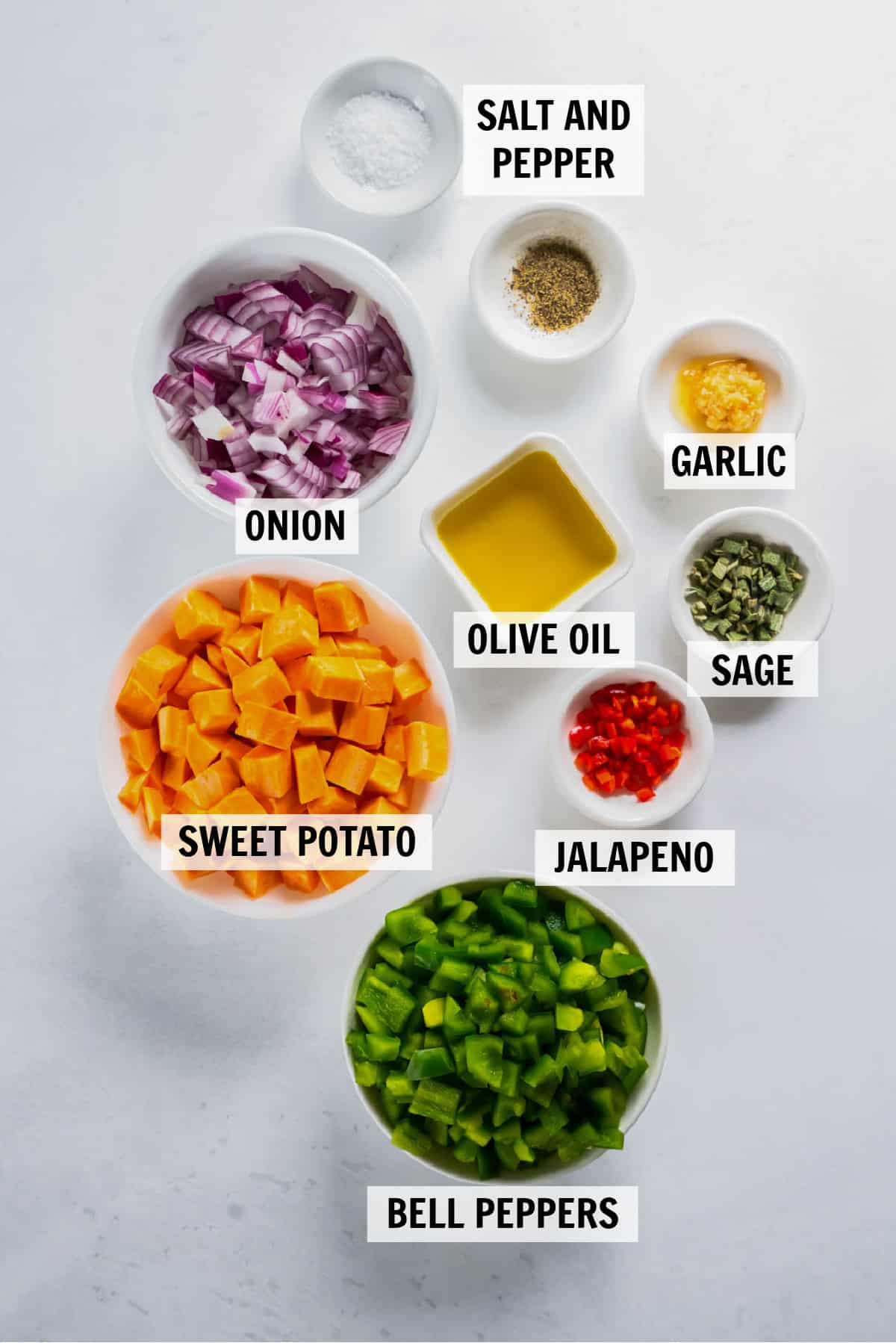 all of the ingredients for sweet potato hash in bowls on a white countertop