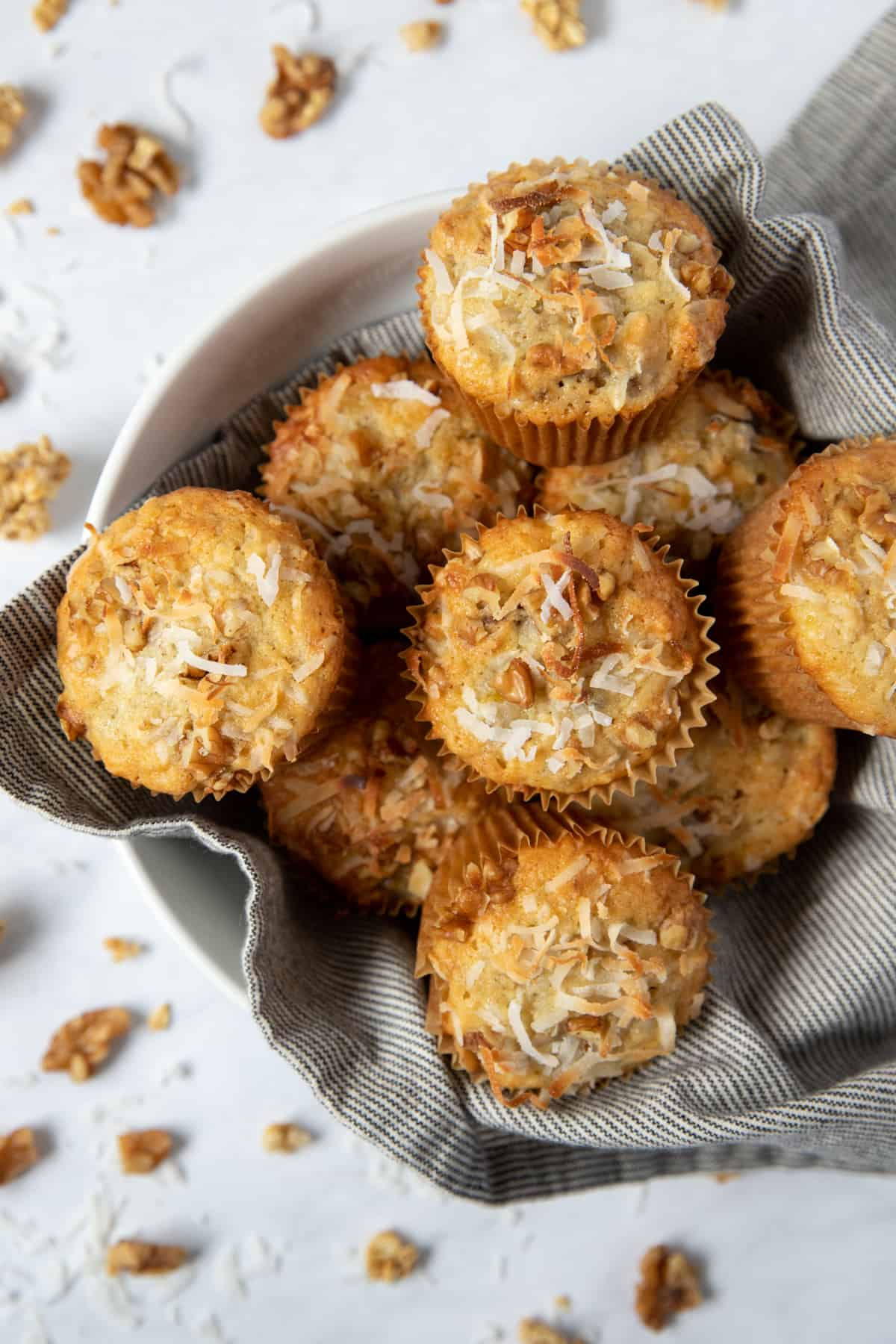 a bowl filled with banana coconut muffins