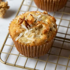 close up photo of one banana coconut muffin